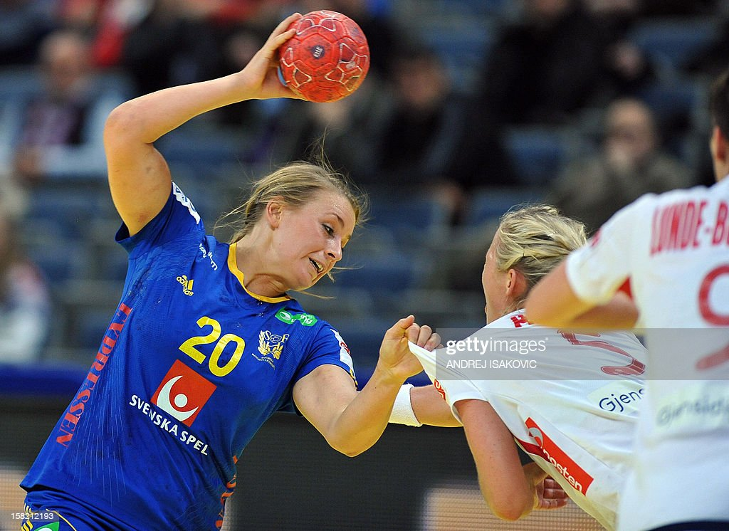 Sweden's Isabelle Gullden (L) vies with Norway's Ida Alstad (R) during the Women's EHF Euro 2012 Handball Championship match Norway vs Sweden on December 11, 2012, at the Belgrade Arena. AFP PHOTO / ANDREJ ISAKOVIC