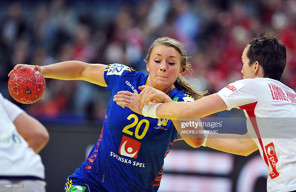 Sweden's Isabelle Gullden (L) vies with Norway's Kristine Lunde-Borgersen during the Women's EHF Euro 2012 Handball Championship match Norway vs Sweden on December 11, 2012, at the Belgrade Arena.