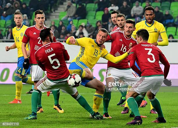 Sweden's Jakob Johansson fights for the ball with Hungary's Endre Botka Attila Fiola Adam Pinter and Szilveszter Hangya during the friendly football...