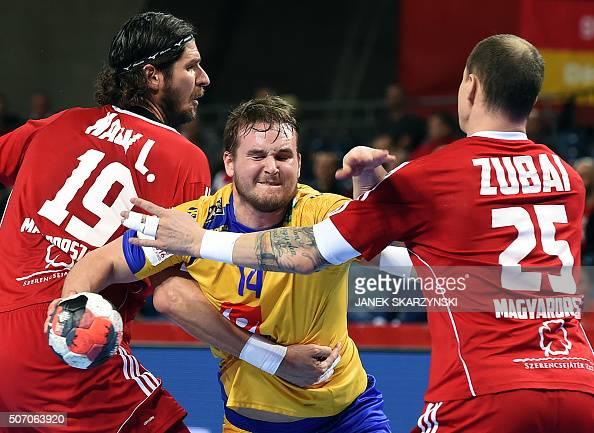 Sweden's Jesper Konradsson vies with Hungary's Laszlo Nagy and Szabolcs Zubai during the Men's 2016 EHF European Handball Championships between...