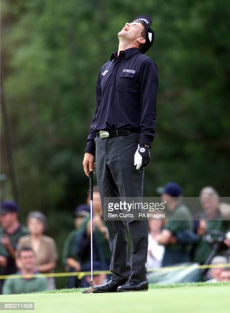 Sweden's Jesper Parnevik cannot believe his luck after missing a putt on the 18th as Scotland's Colin Montgomerie won the Standard Life Loch Lomond...