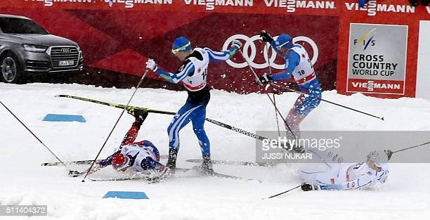 Sweden's Johan Edin and Finland's Matias Strandvall crash during the Men's CrossCountry Skiing Freestyle Sprint Finals at the Lahti Ski Games the...