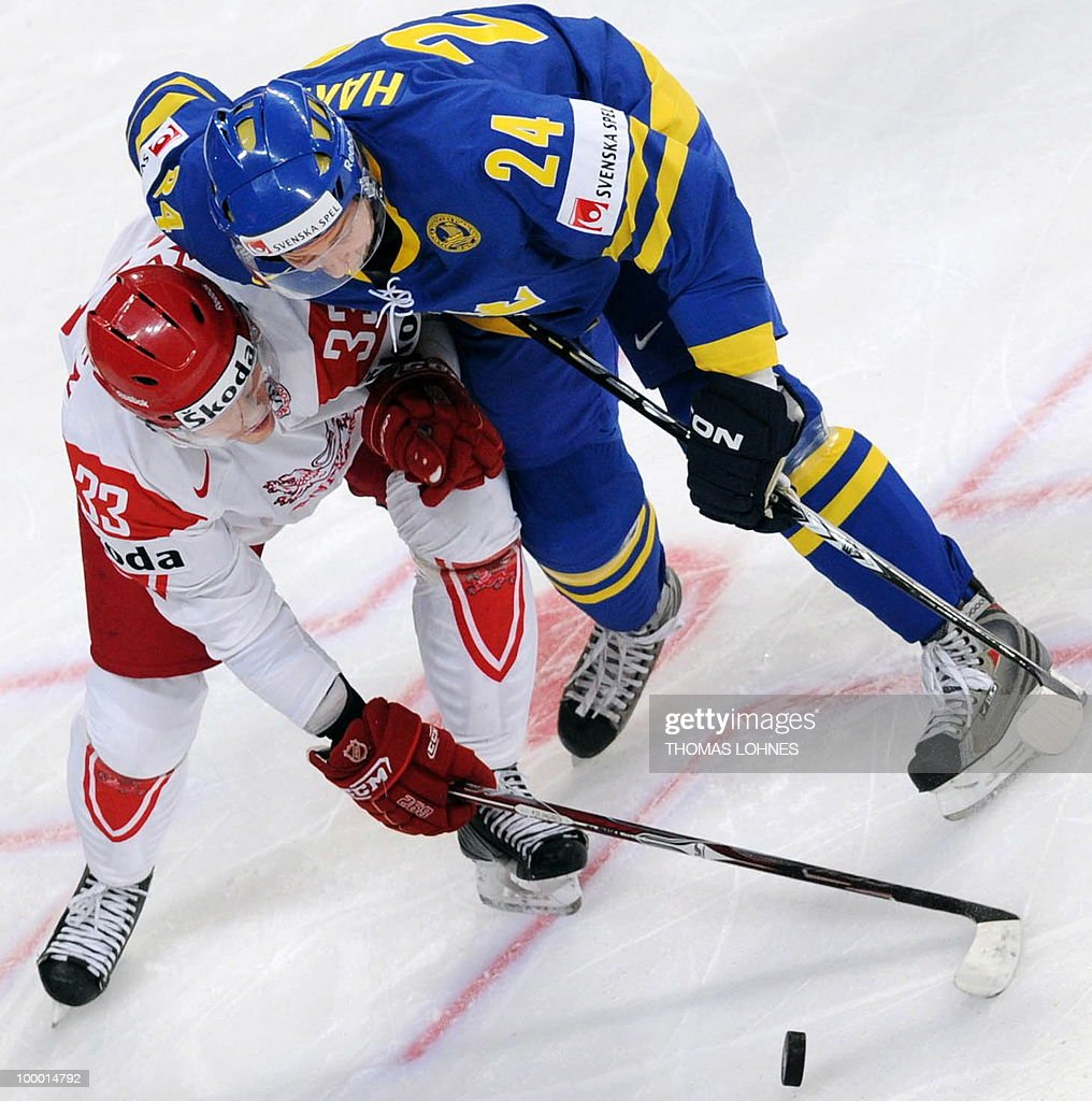 Sweden's Johan Harju (R) and Denmark's Julian Jakobsen vies during the IIHF Ice Hockey World Championship quarter-final match Sweden vs Denmark in the southern German city of Mannheim on May 20, 2010. The 2010 IIHF Ice Hockey World Championships are taking place in Germany from May 7 to 23, 2010.