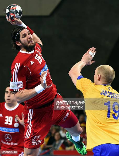 Sweden's Johan Jakobsson vies with Hungary's Laszlo Nagy during the Men's 2016 EHF European Handball Championships between Hungary and Sweden in...
