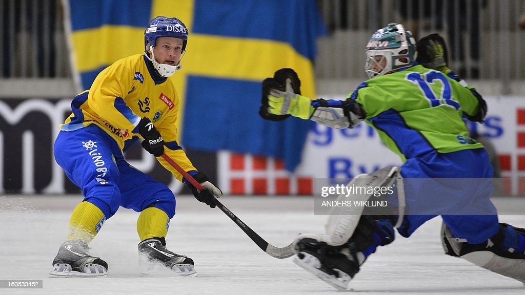 Sweden's Johan Loefstedt scores the 10-2 goal past Finland's goalkeeper Kimmo Kylloenen during Bandy World Championship semifinal match Sweden vs Finland in Vanersborg, Sweden, February 2, 2013. AFP PHOTO / SCANPIX / ANDERS WIKLUND SWEDEN OUT