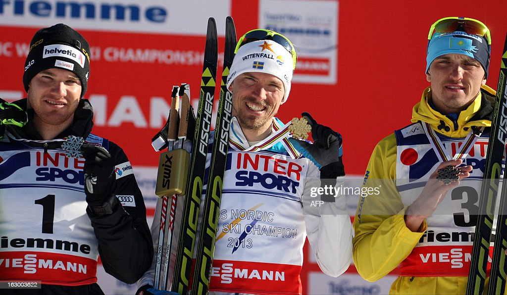 Sweden's Johan Olsson (C) poses on the podium on March 3, 2013 with silver medalist Switzerland's Dario Cologna (L) and bronze medalist Kazakhstan's Alexey Poltoranin after he won the Men's Cross Country skiing 50 Km Classic Mass Start of the FIS Nordic World Ski Championships at Val Di Fiemme Cross Country stadium in Cavalese, northern Italy.