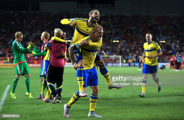 Sweden's John Guidetti and Abdul Khalili celebrate after Sweden win the penalty shootout