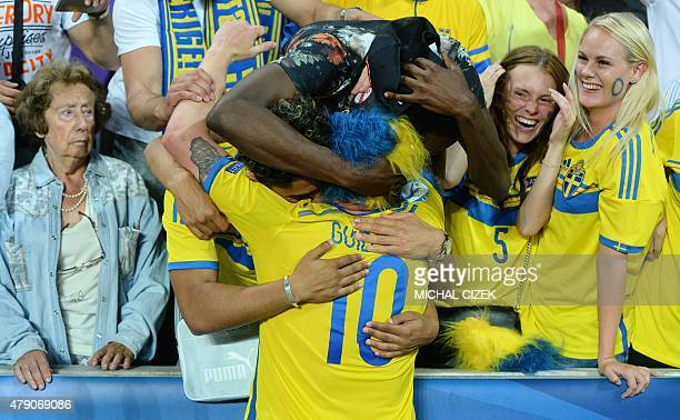 Sweden's John Guidetti celebrates with Swedish fans after winning the UEFA Under 21 European Championship 2015 final football match between Sweden...