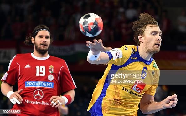 Sweden's Jonas Kallman vies with Hungary's Laszlo Nagy during the Men's 2016 EHF European Handball Championships between Hungary and Sweden in...