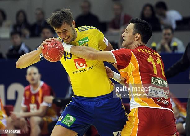 Sweden's Jonas Larholm vies with FYR Macedonia's Vladimir Temelkov during their 10th EHF European 2012 Men's Handball Championship match at the Cair...