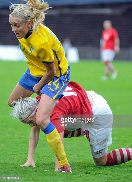 Sweden's Josefine Oqvist runs over Wales' Jessica Fishlock during the women's World Cup football match in Vaxjo on August 25 2010 AFP PHOTO/ PATRIC...