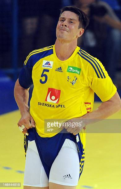 Sweden's Kim Andersson reacts during the 2013 Men's World Championship play off handball match between Montenegro and Sweden in Podgorica on June 16...