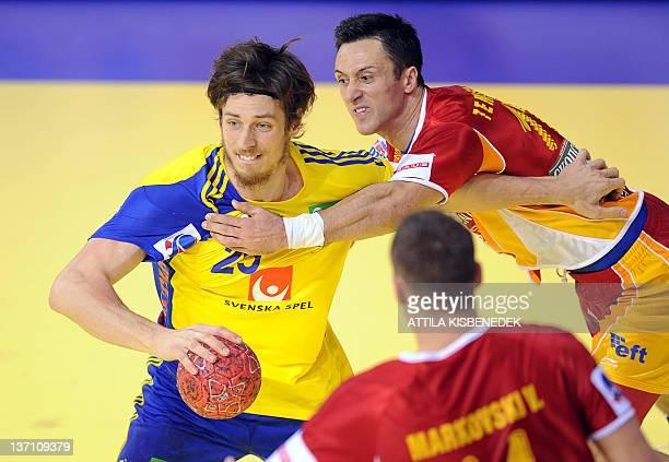 Sweden's Kim Ekdahl Du Rietz vies with FYR Macedonia's Vladimir Temelkov during the 10th 2012 EHF European Men's Handball Championship match at the...