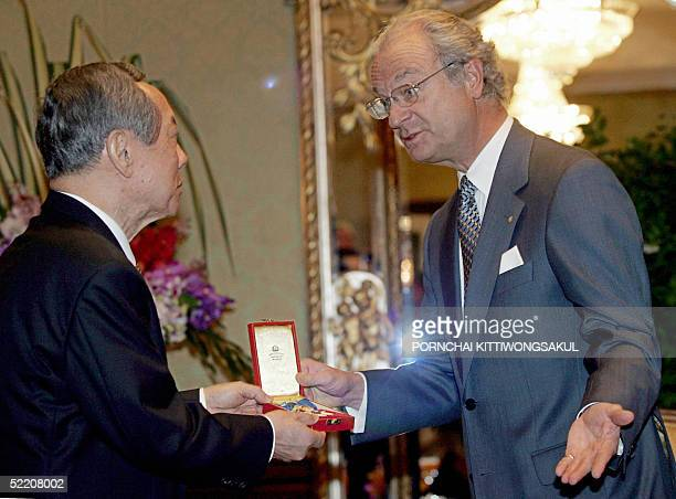 Sweden's King Carl XVI Gustaf gives a Royal Decoration to Thai business leader Thamnoon Wanglee for promoting ThaiSwedish relations particularly in...