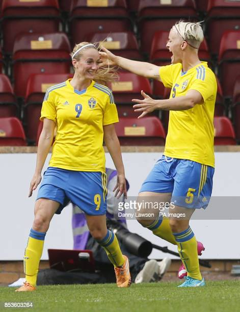 Sweden's Kosovare Asllani celebrates her goal with team mate Nilla Fischer during the FIFA Women's World Cup qualifying match at Fir Park Motherwell