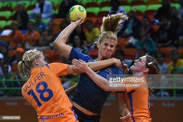 TOPSHOT Sweden's left back Linnea Torstensson vies with Netherlands' left back Kelly Dulfer and Netherlands' right back Laura van der Heijden during...