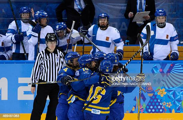 Sweden's Lina Wester celebrates with her teammates after scoring her team's second goal during the Women's Ice Hockey Playoffs Quarterfinals match...