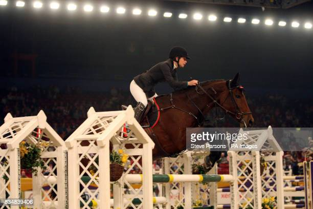 Sweden's Linda Head riding Columbus competes in the Dick Turpin Stakes during day three of the Horse of the Year Show at the NEC in Birmingham