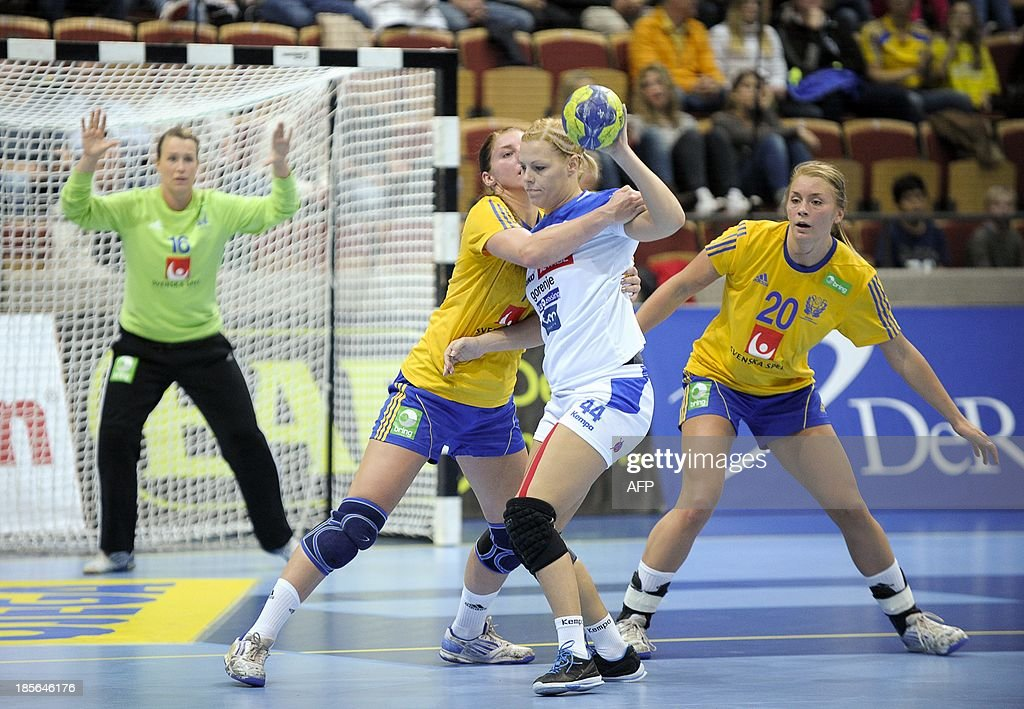 Sweden's Linn Blohm (2ndL) tries to stop Slovenia's Ana Petrinja as Sweden's Isabelle Gullden (R) and goalkeeper Cecilia Skagerstam Grubbstroem (L) look on during their EHF Women's European Championship qualification match between Sweden and Slovenia at Helsingborg Arena on October 23, 213. AFP PHOTO/ Bjorn Lindgren / TT
