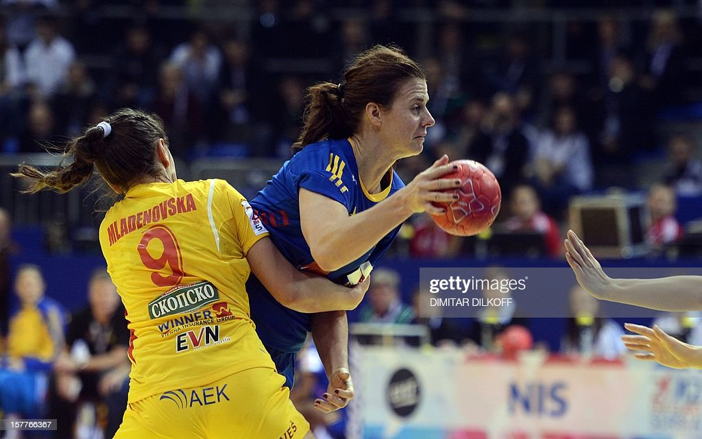 Sweden's Linnea Torstenson (R) vies with Macedonia's Natasha Mladenovska (L) during the Women's EHF Euro 2012 Handball Championship match between Macedonia and Sweden in Nis on December 6, 2012.