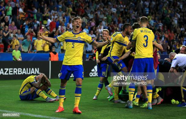 Sweden's Ludwig Augustinsson and teammates celebrate after Sweden win the penalty shootout
