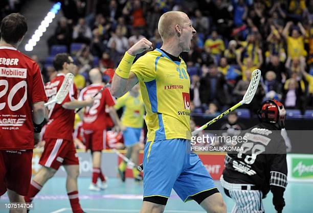 Sweden's Magnus Svensson celebrates after scoring the opening 01 against Switzerland next to Swiss Markus Gerber Swiss goalkeeper Philipp Gerberand...