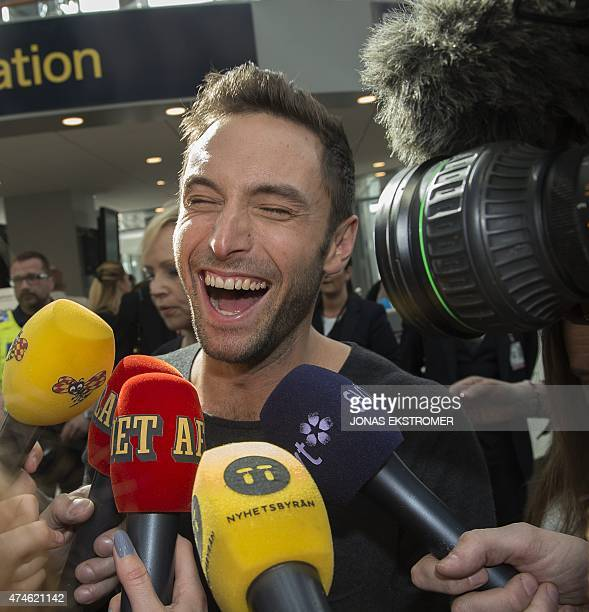 Sweden's Mans Zelmerloew is greeted by fans and the press as he arrives at Arlanda Airport north of Stockholm on May 24 2015 the day after winning...