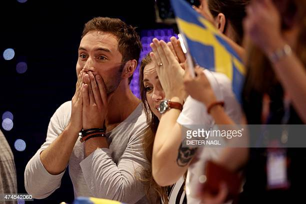 Sweden's Mans Zelmerlow celebrates winning the 60th Eurovision Song Contest final on May 23 2015 in Vienna NAGL