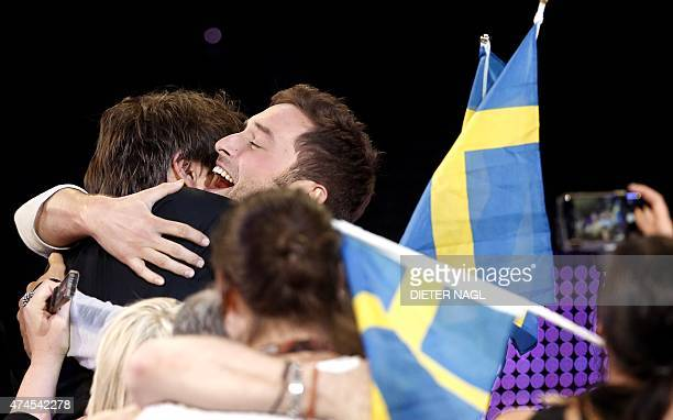 Sweden's Mans Zelmerlow reacts after winning the Eurovision Song Contest final on May 23 2015 in Vienna AFP PHOTO / DIETER NAGL