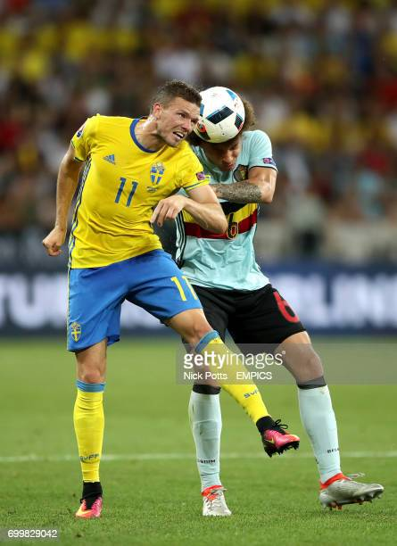 Sweden's Marcus Berg and Belgium's Axel Witsel battle for the ball