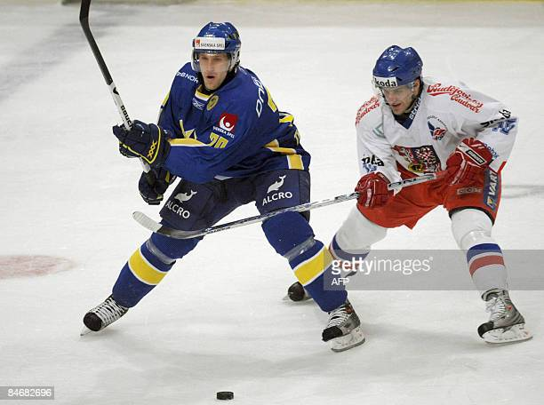 Sweden's Martin Thornberg fights for the puck with Czech Republic's Jan Marek in their match of the Euro hockey tour in Stockholm on February 7 2009...