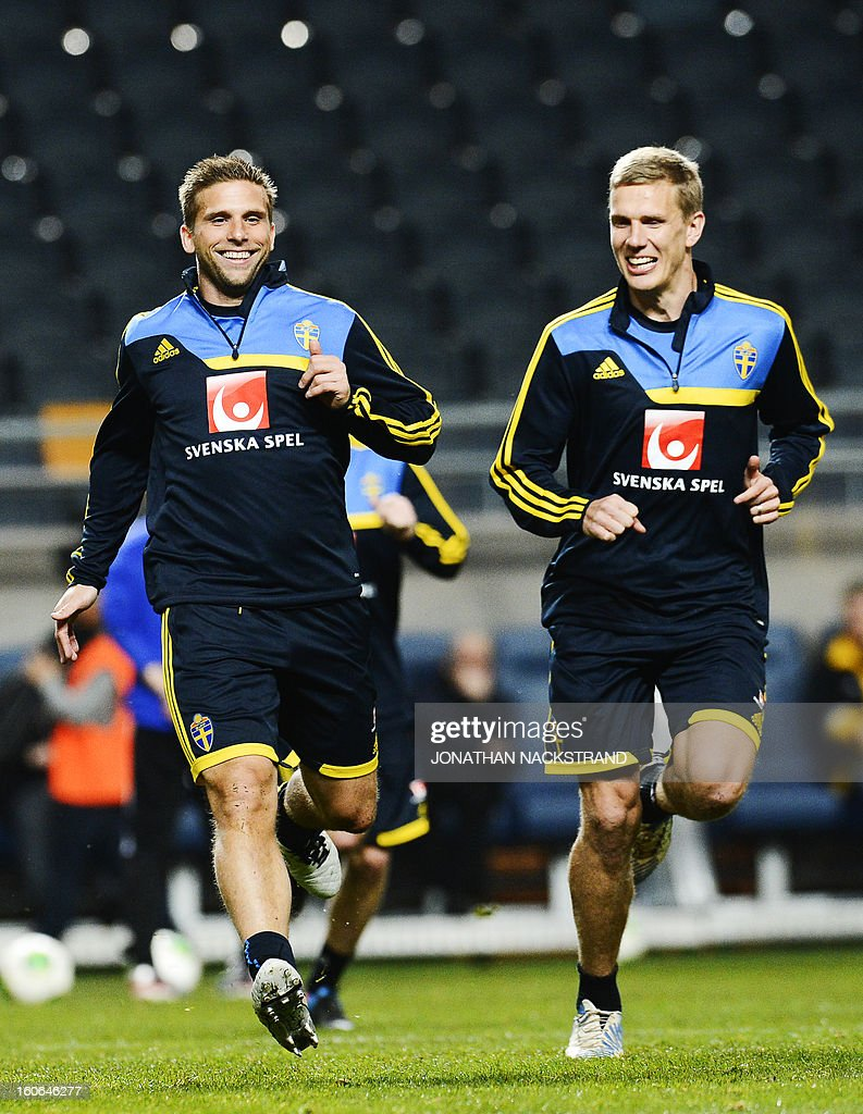 Sweden's midfielder Anders Svensson (L) and midfielder Pontus Wernbloom take part in a training session of the Swedish national football team at the 'Friends Arena' in Stockholm, Sweden, on February 4, 2013 two days before the FIFA World Cup 2014 friendly match Sweden vs Argentina.
