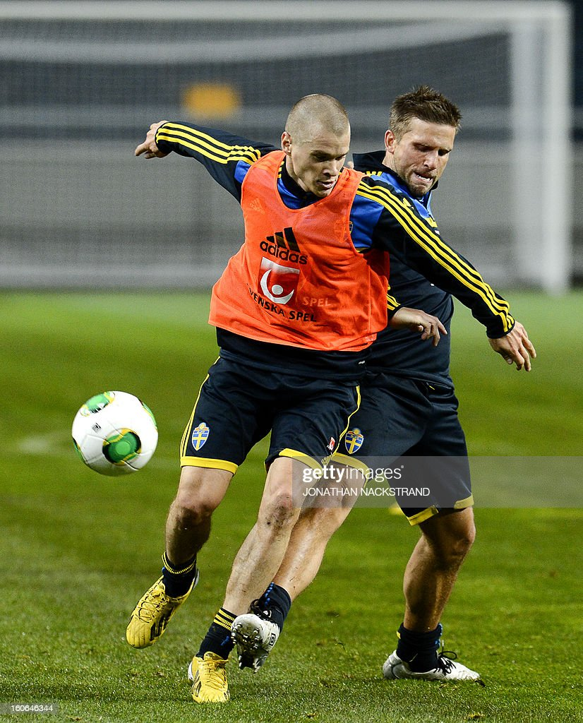 Sweden's midfielder Anders Svensson (R) and midfielder Samuel Holmen take part in a training session of the Swedish national football team at the 'Friends Arena' in Stockholm, Sweden, on February 4, 2013 two days before the FIFA World Cup 2014 friendly match Sweden vs Argentina.