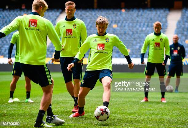 Sweden's midfielder Emil Forsberg and defender Pontus Jansson attend a training session of the Swedish national football team on the eve of the WC...