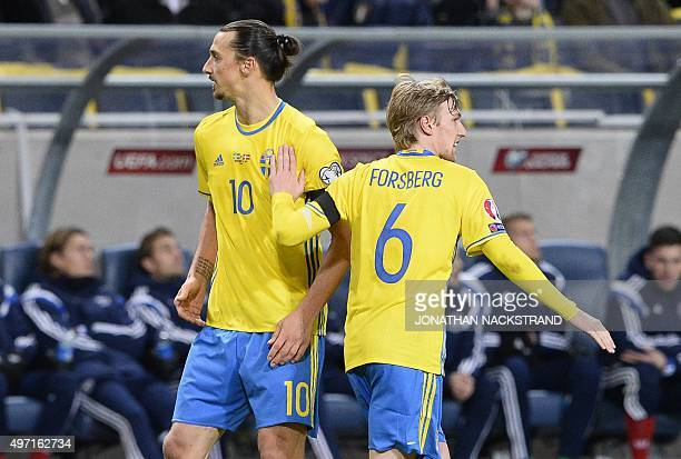 Sweden's midfielder Emil Forsberg celebrates with his teammate forward and team captain Zlatan Ibrahimovic after scoring a goal during the Euro 2016...