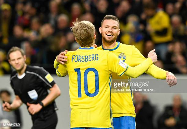 Sweden's midfielder Emil Forsberg celebrates with his teammate forward Marcus Berg after scoring during the FIFA World Cup 2018 qualification...