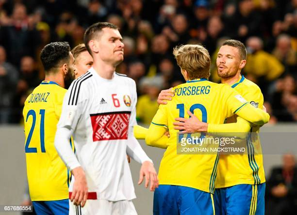 Sweden's midfielder Emil Forsberg celebrates with his teammates after scoring during the FIFA World Cup 2018 qualification football match between...