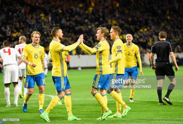 Sweden's midfielder Emil Forsberg celebrates with his teammates after scoring a goal during the FIFA World Cup 2018 qualification football match...