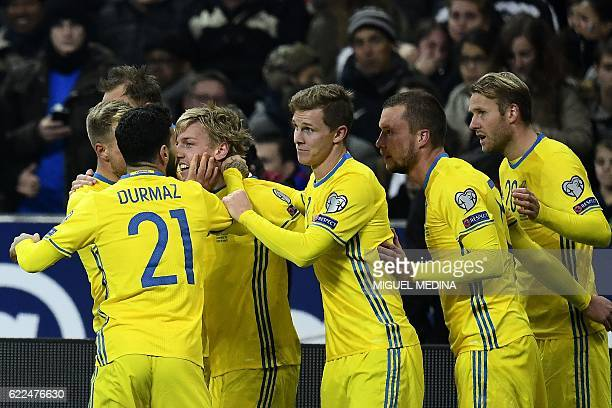 Sweden's midfielder Emil Forsberg celebrates with teammates after scoring a goal during the 2018 World Cup group A qualifying football match between...