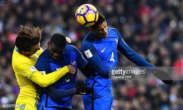 Sweden's midfielder Emil Forsberg challenges France's midfielder Paul Pogba and France's defender Raphael Varane just before France's second goal...