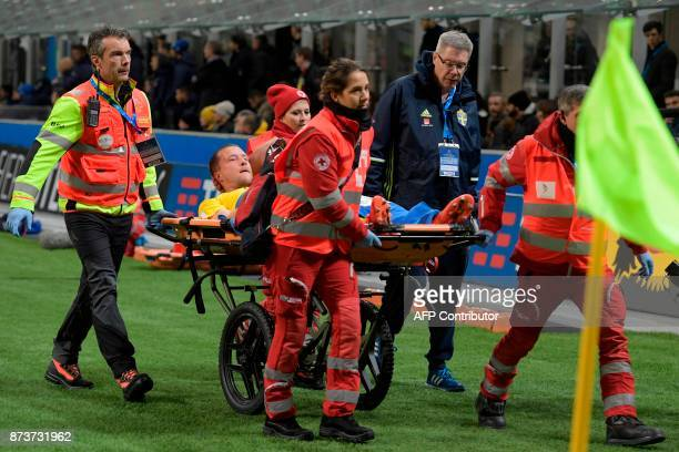 Sweden's midfielder Jakob Johansson leaves the pitch on a stretcher during the FIFA World Cup 2018 qualification football match between Italy and...