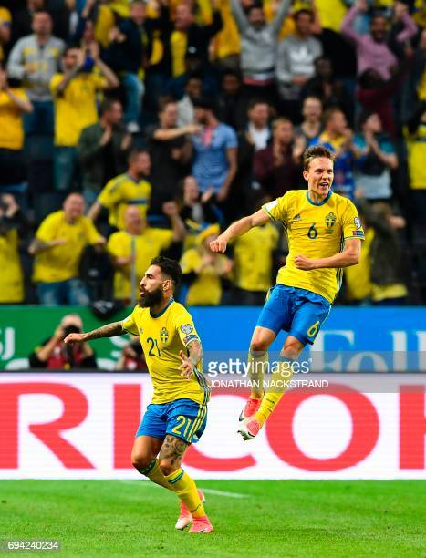 Sweden's midfielder Jimmy Durmaz celebrates with Sweden's Ludwig Augustinsson after scoring during the FIFA World Cup 2018 qualification football...