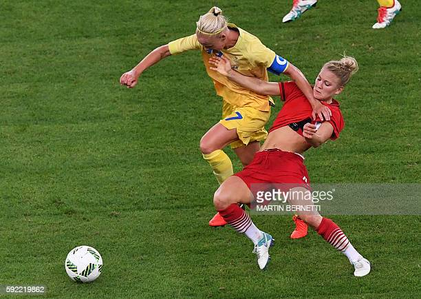 Sweden's midfielder Lisa Dahlkvist and Germany's defender Leonie Maier vie for the ball during the Rio 2016 Olympic Games women's football Gold medal...