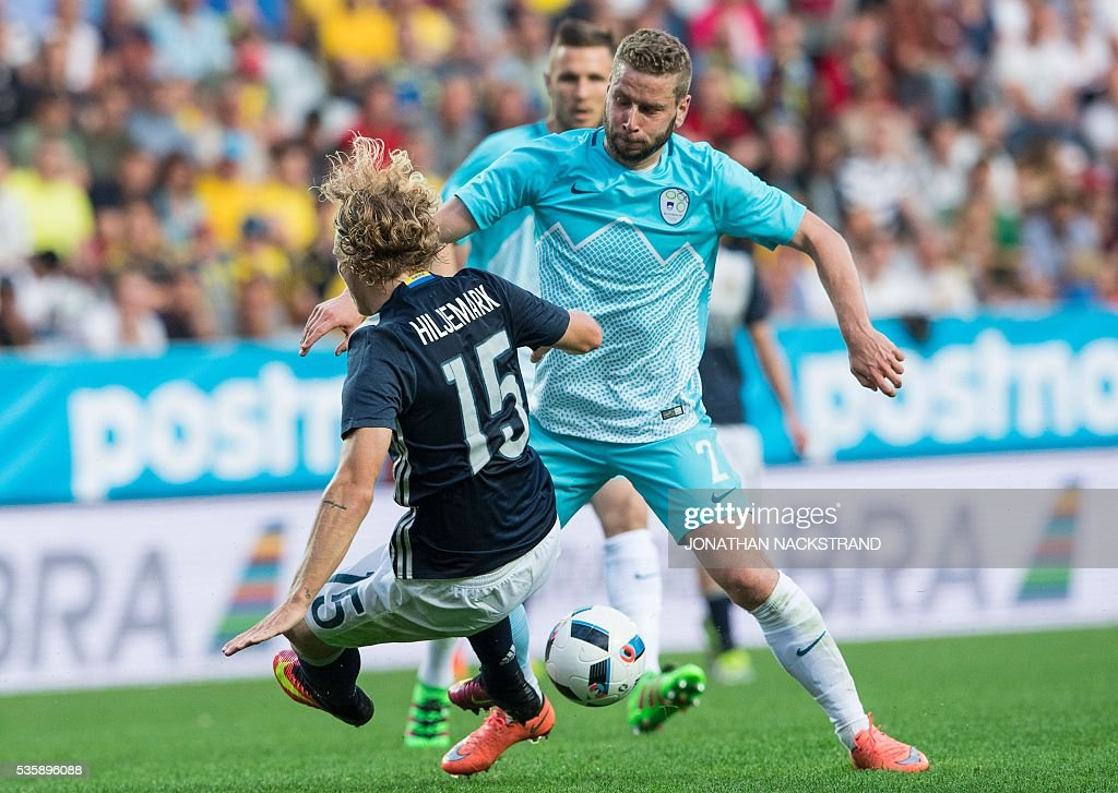 Sweden's midfielder Oscar Hiljemark (L) vies with Slovenia's midfielder Rok Kronaveter during the friendly football match between Sweden and Slovenia at Swedbank stadium in Malmo on May 30, 2016. / AFP / JONATHAN