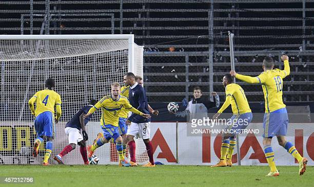 Sweden's midfielder Oscar Lewicki celebrates after scoring a goal during the UEFA U21 European Championships qualifying football match between Sweden...