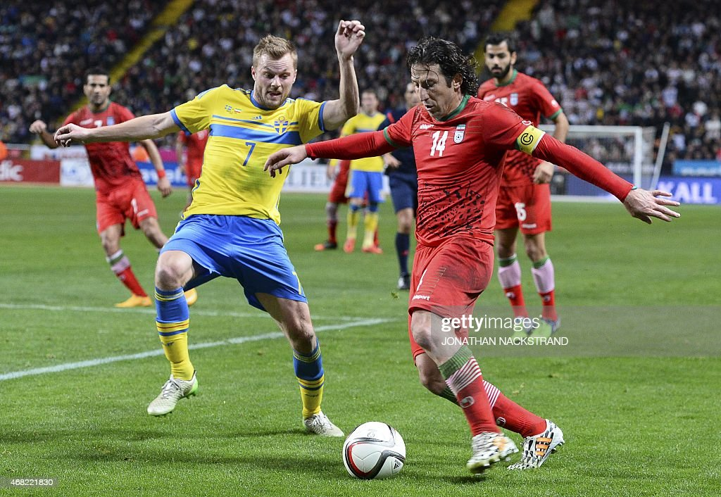 Sweden's midfielder <a gi-track='captionPersonalityLinkClicked' href=/galleries/search?phrase=Sebastian+Larsson&family=editorial&specificpeople=719331 ng-click='$event.stopPropagation()'>Sebastian Larsson</a> (L) vies with Iran's midfielder <a gi-track='captionPersonalityLinkClicked' href=/galleries/search?phrase=Andranik+Teymourian&family=editorial&specificpeople=551220 ng-click='$event.stopPropagation()'>Andranik Teymourian</a> vie for the ball during the friendly international football match between Sweden and Iran at the Friends Arena in Solna near Stockholm on March 31, 2015.
