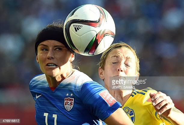 Sweden's midfielder Therese Sjogran and USA defender Alex Kerieger fight for the ball during their Group D match of the 2015 FIFA Women's World Cup...