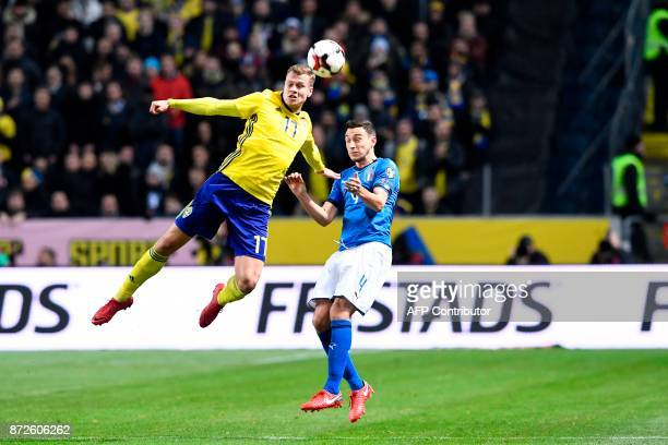 Sweden's midfielder Viktor Claesson and Italy's midfielder Matteo Darmian vie for the ball during the FIFA World Cup 2018 qualification football...