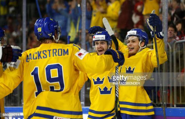 Sweden's Nicklas Backstrom Oliver EkmanLarsson and William Nylander celebrate a goal during the IIHF Men's World Championship Ice Hockey semifinal...