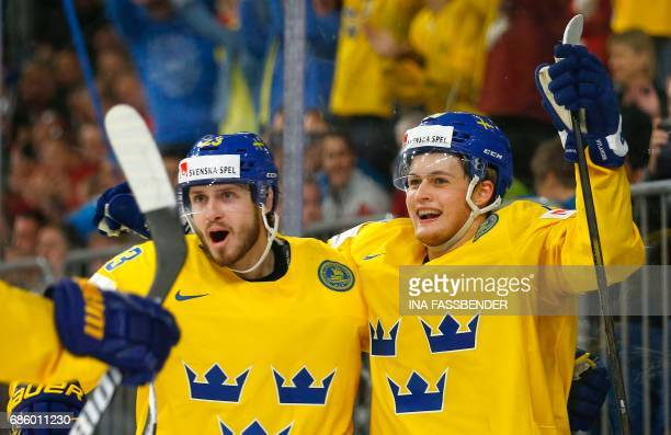 Sweden's Oliver EkmanLarsson and William Nylander celebrate a goal during the IIHF Men's World Championship Ice Hockey semifinal match between Sweden...
